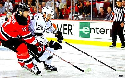 The Devils' Ilya Kovalchuk goes against the Kings' Slava Voynov in Game 5.