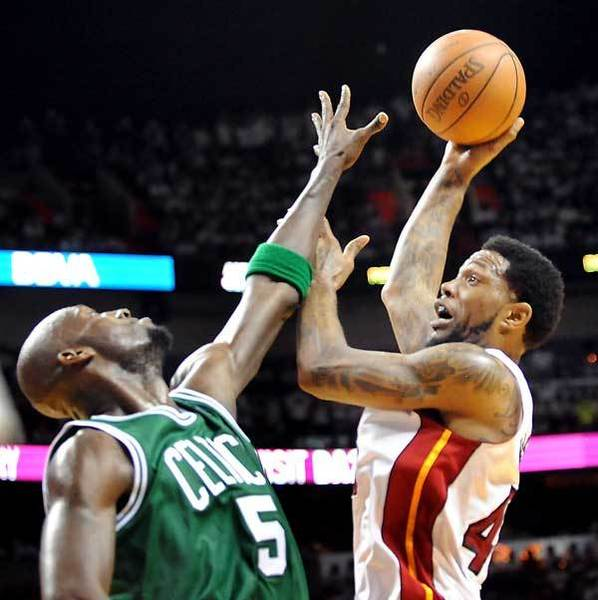 Udonis Haslem takes a shot over Boston's Kevin Garnett.