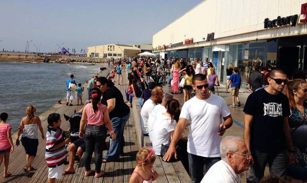 Tel Aviv Port retail promenade has become one of the Israeli city's busiest attractions on Saturdays, despite government restrictions on operating on the Jewish Sabbath.