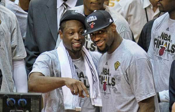 Miami Heat's LeBron James and Dwyane Wade celebrate winning Game 7 of the Eastern Conference Finals, Saturday, June 9, 2012, at AmericanAirlines Arena.