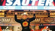 One year removed from a black-flag penalty that cost him a NASCAR Camping World Truck Series win here, Johnny Sauter belatedly pulled into Victory Lane at Texas Motor Speedway on Friday night.