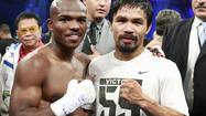 LAS VEGAS — Minutes after Manny Pacquiao entered a post-fight press conference with an unmarked face, his injured opponent Timothy Bradley was wheeled into the same room.