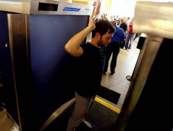 The author of the study by the Marquette University College of Engineering based her conclusions on scanner radiation data released publicly by the TSA. Above, a traveler passes through one of the full-body scanners last year at Los Angeles International Airport.