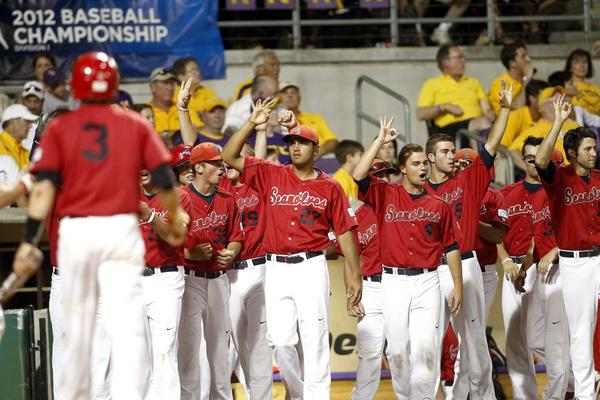 Stony Brook's Pat Cantwell is congratulated by teammates after scoring a run against LSU in the fourth inning of Game 3.