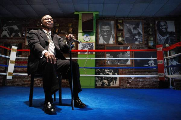 Former heavyweight boxing champion Joe Frazier poses for a portrait at his gym in Philadelphia in 2009. Now the site is for sale and preservationists are clamoring to save it.