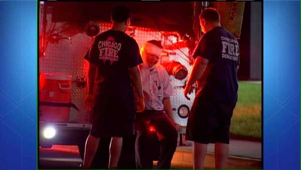 Chicago Fire Department paramedics treat a beating victim in the Gold Coast neighborhood.