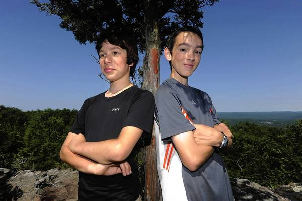 Andrew Godin,11, left, and Michael Godin, 12, have climbed all 48 mountains in New Hampshire above 4000 feet.