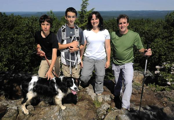 Left to right: Andrew Godin, 11, Michael Godin, 12, Lori Godin and Chris Godin hike King Philip Mountain on the Metacomet trail in Simsbury. Michael and Andrew have climbed all 48 mountains in New Hampshire above 4000 feet.
