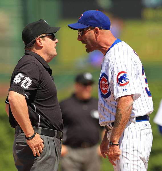 Cubs manager Dale Sveum takes out some of his frustrations on an umpire.