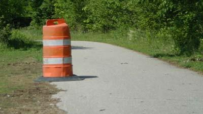 An area of damaged pavement is seen along the Little Traverse Wheelway northeast of Petoskey.