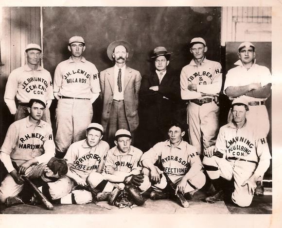A circa 1910 Huntington Beach amateur league baseball team sponsored by local merchants. Huntington Beach's first mayor, plumber Ed Manning (who sponsored a team) is in the back row, fourth from the left in the dark suit.
