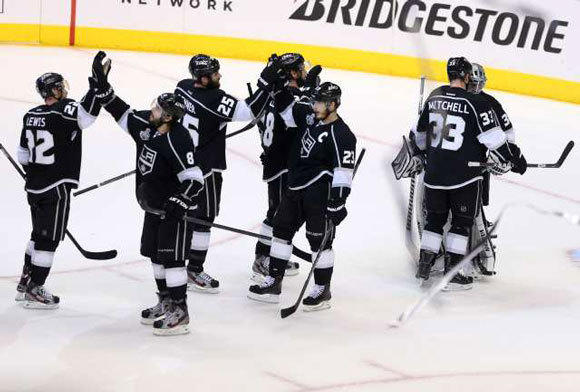 Some of the Kings congratulate each other after defeating New Jersey in Game 3.