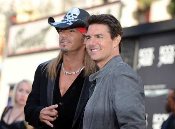 "Bret Michaels and Tom Cruise pose on the red carpet at ""Rock of Ages."""