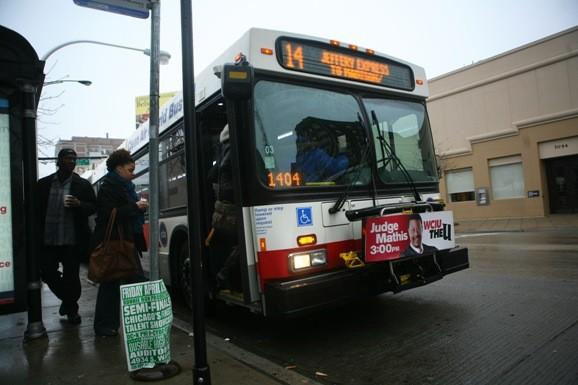 The CTA No. 14 Jeffery Express bus picks up commuters at 71st and Jeffrey. The route will be part of a bus rapid transit experiment to improve service on the South Side. (Tribune photo)