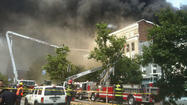 Five-alarm fire engulfs Fells Point building, disrupts neighborhood