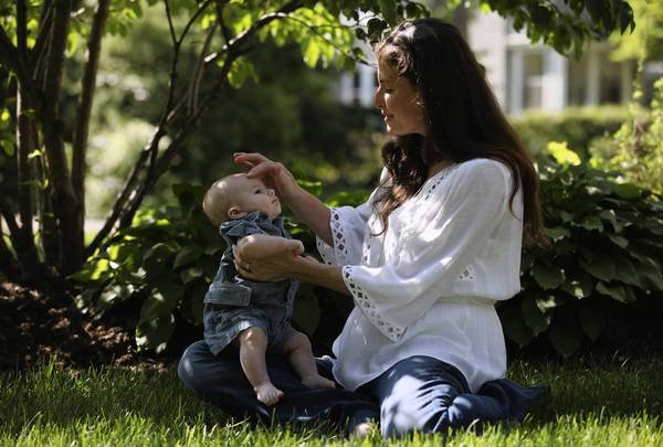 Sarah Benedict(cq) and her 3-month-old son Andrew Bero(cq), outside their home in Hinsdale, Tuesday May 22, 2012.