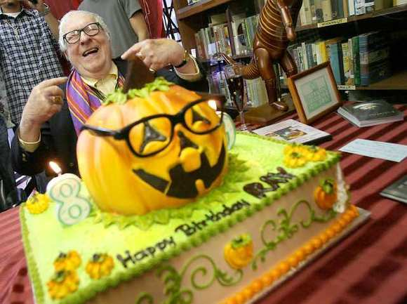 Author Ray Bradbury grins as he's presented with his 89th birthday cake Saturday.