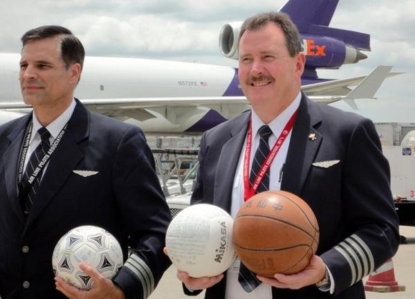 FedEx pilots arrived in Japan, Monday, carrying a basketball lost after last year's tsunami.
