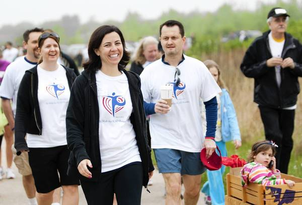 Deb McGarry, of Naperville, participates in a 5K walk May 5 hosted by the SCAD Survivors Reunion at the Springbrook Prairie Forest Preserve in Naperville. McGarry survived a heart attack in January 2011 caused by SCAD, or spontaneous coronary artery dissection. It's a rare, often fatal heart condition.