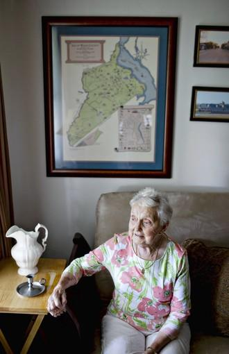 Grace Keen, 85, sits under a map of Isle of Wight County inside her home. Keen has been has been a county government watchdog for decades.
