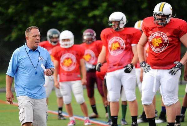 East Stroudsburg North's Chuck Dailey (left) instructs the Lehigh, Carbon and Monroe County team before practice on Monday.