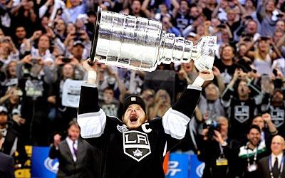 Los Angeles Kings Captain Dustin Brown celebrates with the Stanley Cup after the Kings defeated the New Jersey Devils 6-1 in Game 6 of the Stanley Cup Final.