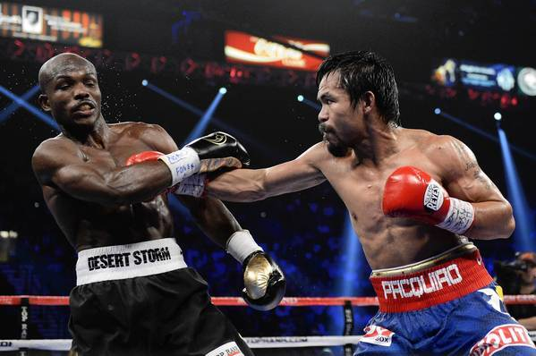 Manny Pacquiao lands a right to the head of Timothy Bradley during their WBO welterweight title fight at MGM Grand Arena on June 9, 2012 in Las Vegas.