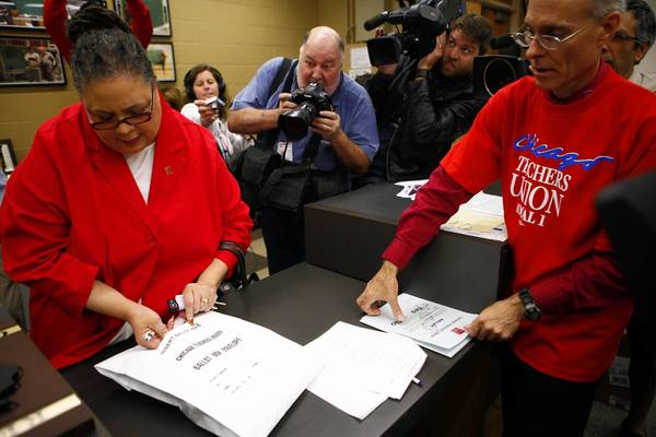 Chicago Teachers Union President Karen Lewis casts her vote on strike authorization Wednesday at King College Prep. The union announced Monday that nearly 90 percent of its members authorized a walkout.