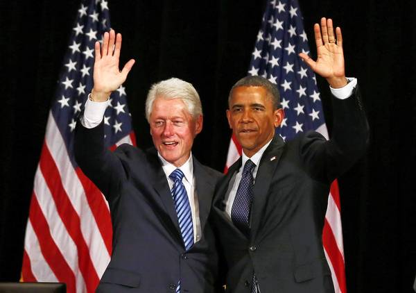 Former U.S. President Bill Clinton and U.S. President Barack Obama wave during a fundraiser at the Waldorf Astoria in New York June 4, 2012.