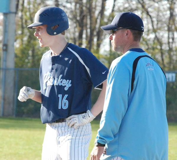 Hunter Stinger (left) is one of four Petoskey High School senior baseball players who will play Wednesday in the annual Near-Far All-Star Game in Traverse City. Northmen assistant coach Kevin Horn (right) and head coach Shawn Racignol will lead the Far Team.