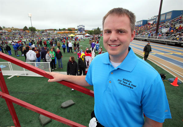 Aberdeen native James Weaver just completed his first season as assistant executive director with South Dakota High School Activities Association. Although Weaver administers fine arts activities, he can also be found behind the scenes at state athletic events such as, the recent state track and field meet in Rapid City. American News Photo by John Davis