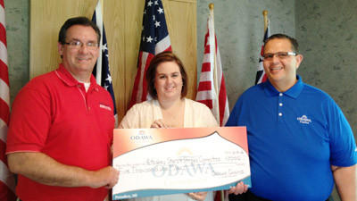 Marty Van De Car of the Odawa Casino (right) presents a $5,000 check on behalf of the casino to the Petoskey Stars & Stripes Committee to help launch fundraising for Petoskeys Fourth of July festivities. Accepting the check are Carlin Smith (left), chairman of the Stars & Stripes Committee, and Erin Ver Berkmoes of the Petoskey Area Jaycees.