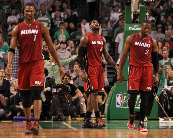 The Miami Heat's Chris Bosh (from left), LeBron James and Dwyane Wade during Game 6 against the Boston Celtics on Thursday.