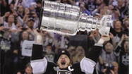 "<span class=""abody"">LOS ANGELES — The Los Angeles Kings, born as one of six expansion teams for the 1967-68 season, ended 45 years of wandering in the NHL wilderness</span><span class=""abody""> Monday night.</span> Captain Dustin Brown re-emerged in the Stanley Cup Final series with a goal and two assists, getting the Kings started on a 6-1 victory over the New Jersey Devils at Staples Center. Brown is the second Americanborn captain to be presented with the Stanley Cup."
