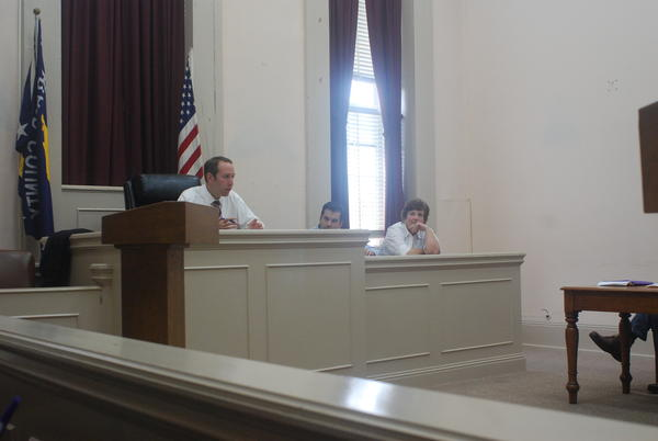 Garrard County Judge-Executive John Wilson, left, listens as residents speak Monday at the Garrard Fiscal Court meeting. Several people spoke in support of Nathan Mick, the county's economic development director. No residents spoke in opposition to the director's salary.