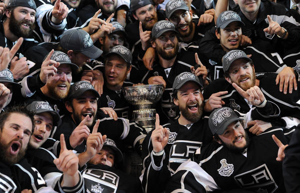 Los Angeles Kings players and coaches pose for a team photo after defeating the New Jersey Devils 6-1 in game six of the 2012 Stanley Cup Finals at the Staples Center. The Kings won the series four games to two.