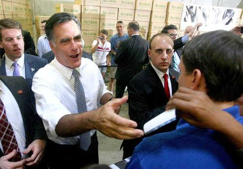 GOP presidential contender Mitt Romney campaigns in Orlando, greeting supporters and delivering remarks during a townhall meeting at Con-Air Industries, an air filter business, in Orlando, Fla., Tuesday, June 12, 2012.