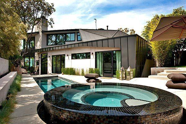 A spa and pool sit outside the Hagy Belzberg-designed home listed for sale at $3.595 million.