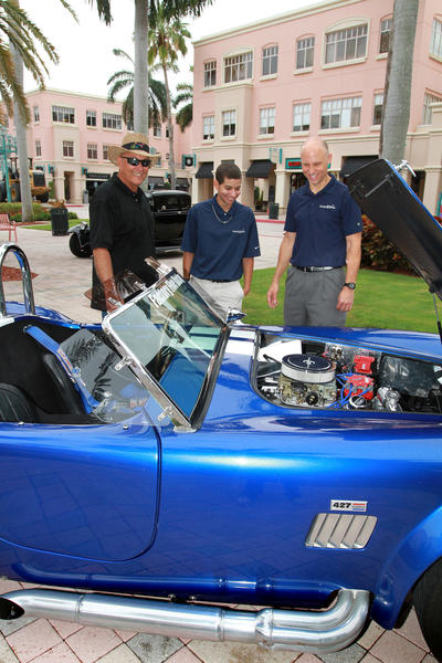 "Owner of the 1966 Cobra replica Joe Bevelacqua, left, shows his car to Nicholas Alvarez and Richard Kelly. More than 100 antique cars will be on display during the second annual ""Mizner Park Downtown Drive Car Show,"" which will benefit Make-a-Wish Foundation of Southern Florida and will take place on June 17."