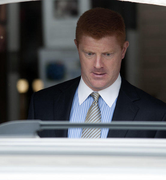 Former Penn State Wide Receivers coach Mike McQueary leaves the Centre County Courthouse in Bellefonte after testifying in the Jerry Sandusky Trial on Tuesday.