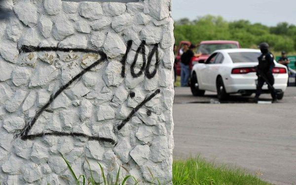 "Grafitti reading ""Z 100%"" -- refering to the Mexican criminal gang Los Zetas -- was left behind along with 49 mutilated bodies on a highway in the state of Monterrey in northern Mexico."