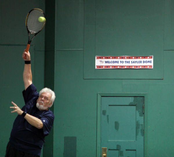 Mike Evans serves the ball at the DownTown Tennis Inc., court, which has been dubbed the Sayler Dome, in honor of Gerald Sayler who started the indoor tennis facility. photo by john davis taken 6/6/2012