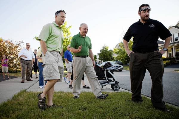 Elgin Mayor David Kaptain, center and city engineers Ron Rudd, left, and Mike Hall, right, participate in a Walk With the Mayor event Wednesday.
