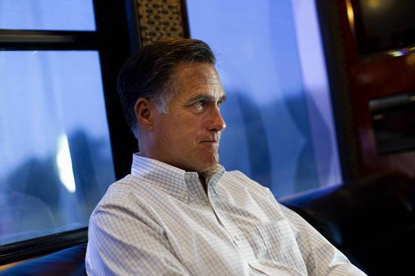 Republican presidential candidate and former Massachusetts Gov. Mitt Romney listens to his staff on his campaign bus after a stop in Council Bluffs, Iowa, this month.