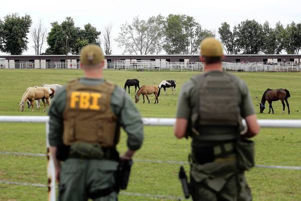 FBI agents look over a horse ranch in Lexington, Okla., that was raided as part of an investigation of alleged money laundering by Mexico's largest drug cartel.