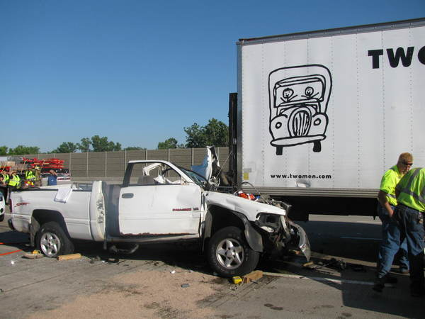 A pickup truck that rear-ended a a moving truck on Interstate 80 in Gary today, killing the pickup's driver.