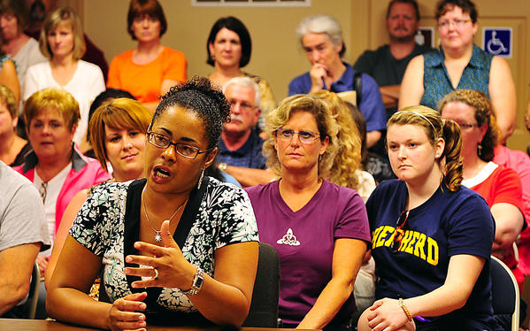 Loren Villa, whose school-age son has Type 1 diabetes, criticizes a recent decision to eliminate funding for the school nurse program in Washington County Public Schools during a Washington County Board of Commissioners meeting Tuesday at Smithsburg Town Hall.
