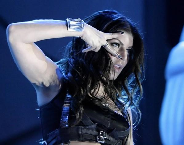 Fergie strikes a pose during the Black Eyed Peas' set at the B96 Summer Bash at Toyota Park in Bridgeview June 13, 2009.