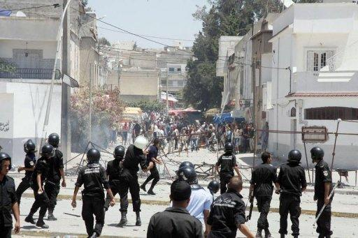 Demonstrators clash with police earlier this week near Tunis.