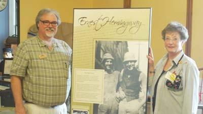 Michigan Hemingway Society president and Little Traverse Historical Society executive director Mike Federspiel (left) and historical society volunteer/museum docent Jean Fought stand with one of the display panels to be featured in an upcoming Ernest Hemingway-focused exhibit at the Little Traverse History Museum in Petoskey's Bayfront Park.